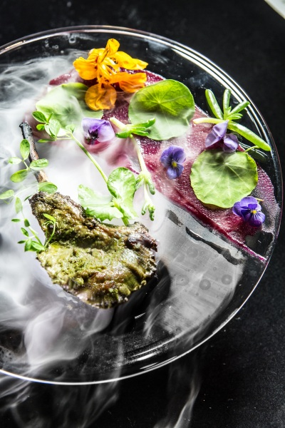 Free-range lamb chops, sous-vide, grilled and finished with green herbs oil; Photo credit - Sansith Koraviyotin