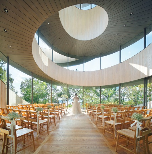 Intertwined spiral staircases meet to form this simple yet stunning chapel