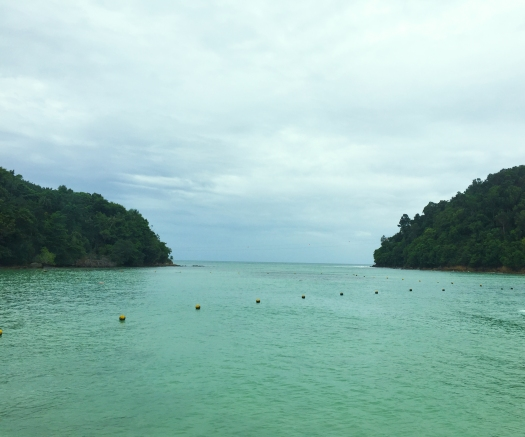 The 250-m Island-to-island zip lining across Sapi Island (left) and Gaya Island